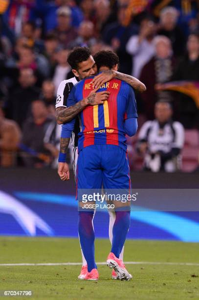 TOPSHOT Barcelona's Brazilian forward Neymar is comforted by Juventus' Brazilian defender Dani Alves after their disqualification by Juventus at the...