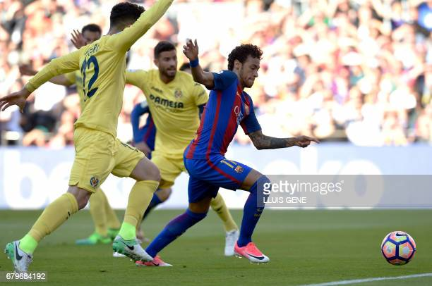 Barcelona's Brazilian forward Neymar kicks the ball to score a goal during the Spanish league football match FC Barcelona vs Villarreal CF at the...