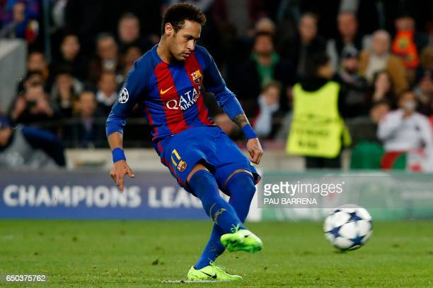 Barcelona's Brazilian forward Neymar kicks to socre on a penalty kick during the UEFA Champions League round of 16 second leg football match FC...