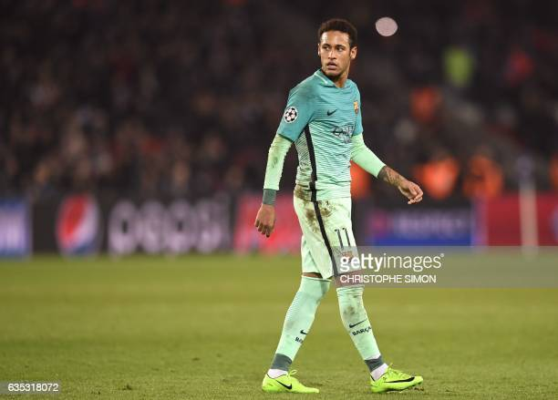 Barcelona's Brazilian forward Neymar reacts at the end of the UEFA Champions League round of 16 first leg football match between Paris SaintGermain...