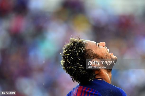 Barcelona's Brazilian forward Neymar reacts during the International Champions Cup match between Juventus FC and FC Barcelona at the MetLife Stadium...