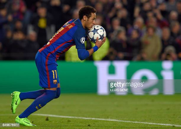 Barcelona's Brazilian forward Neymar runs with the ball after scoring a goal during the UEFA Champions League round of 16 second leg football match...