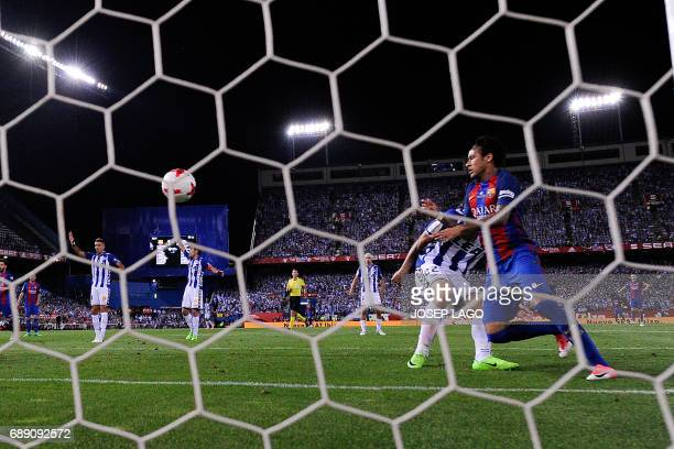 Barcelona's Brazilian forward Neymar scores during the Spanish Copa del Rey final football match FC Barcelona vs Deportivo Alaves at the Vicente...