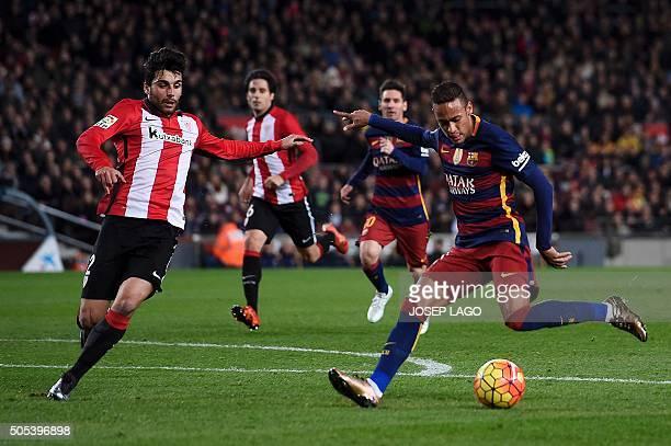 Barcelona's Brazilian forward Neymar scores past Athletic Bilbao's defender Eneko Boveda during the Spanish league football match FC Barcelona vs...
