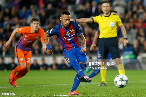 Barcelona's Brazilian forward Neymar shoots a penalty kick during the UEFA Champions League football match FC Barcelona vs Manchester City at the...