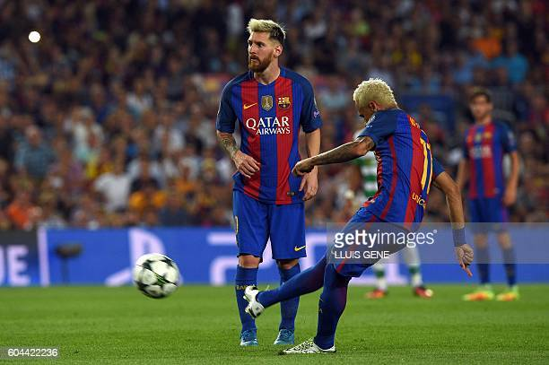Barcelona's Brazilian forward Neymar shoots to score a goal beside Barcelona's Argentinian forward Lionel Messi during their Champions League...