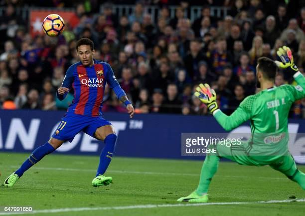 Barcelona's Brazilian forward Neymar shoots to score a goal during the Spanish league football match FC Barcelona vs RC Celta de Vigo at the Camp Nou...