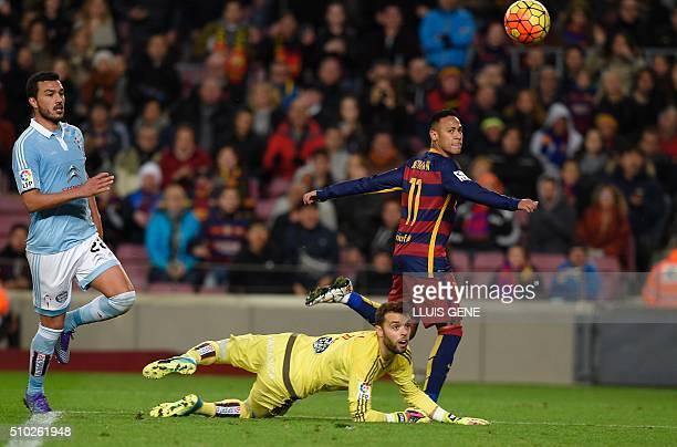 Barcelona's Brazilian forward Neymar shoots to score a goal next to Celta Vigo's goalkeeper Sergio Alvarez during the Spanish league football match...