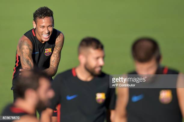 TOPSHOT Barcelona's Brazilian forward Neymar takes part in a training session at Barry University in Miami Florida on July 27 two days before their...