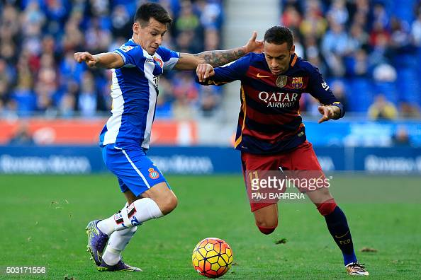 Barcelona's Brazilian forward Neymar vies for a ball with RCD Espanyol's Paraguayan midfielder Hernan Perez during the Spanish league football match...