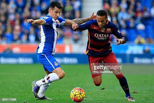 Barcelona's Brazilian forward Neymar vies for a ball with RCD Espanyol's Paraguayan midfielder Hernan Perez during the Spanish league football match...
