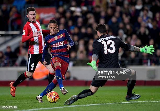 Barcelona's Brazilian forward Neymar vies with Athletic Bilbao's French defender Aymeric Laporte and Athletic Bilbao's goalkeeper Iago Herrerin...