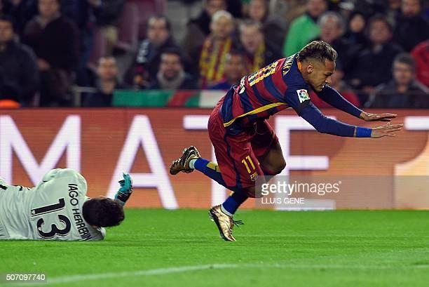 Barcelona's Brazilian forward Neymar vies with Athletic Bilbao's goalkeeper Iago Herrerin during the Spanish Copa del Rey quarterfinals second leg...