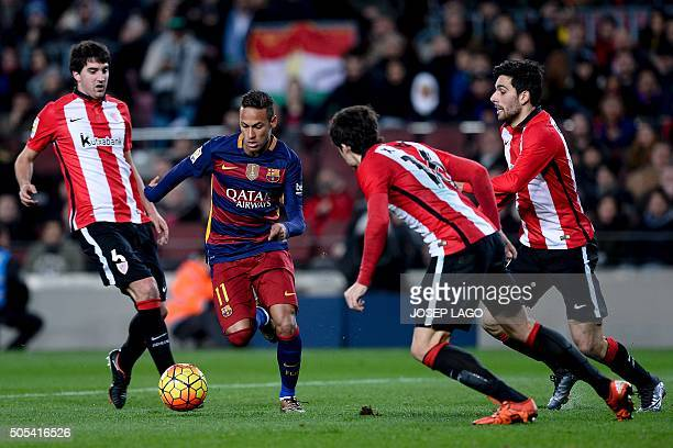 Barcelona's Brazilian forward Neymar vies with Athletic Bilbao's defender Mikel Dominguez and Barcelona's forward Sandro Ramirez during the Spanish...