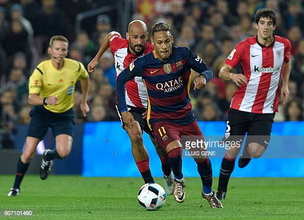 Barcelona's Brazilian forward Neymar vies with Athletic Bilbao's midfielder Mikel Rico during the Spanish Copa del Rey quarterfinals second leg...