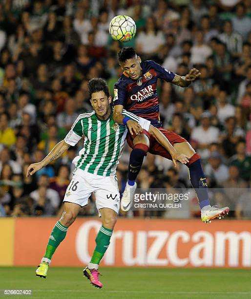 Barcelona's Brazilian forward Neymar vies with Betis' midfielder Alvaro Cejudo during the Spanish league football match Real Betis Balompie vs FC...