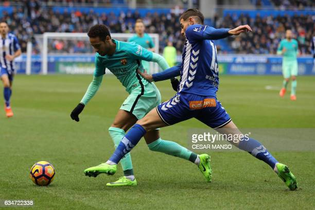 Barcelona's Brazilian forward Neymar vies with Deportivo Alaves French defender Theo Hernandez during the Spanish league football match Deportivo...