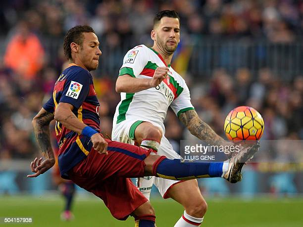 Barcelona's Brazilian forward Neymar vies with Granada's midfielder Edgar during the Spanish league football match FC Barcelona vs Granada CF at the...