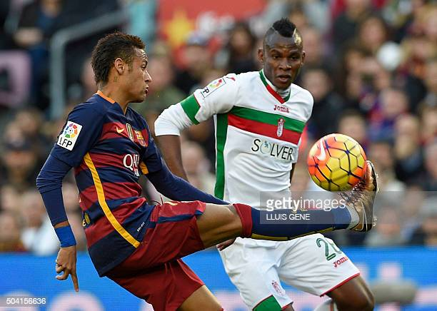 Barcelona's Brazilian forward Neymar vies with Granada's Nigerian midfielder Uche during the Spanish league football match FC Barcelona vs Granada CF...