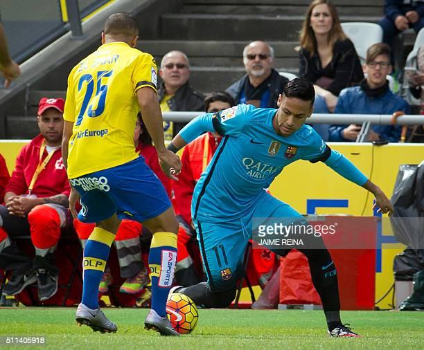 Barcelona's Brazilian forward Neymar vies with Las Palmas' midfielder Roque Mesa Quevedo during the Spanish league football match UD Las Palmas vs FC...