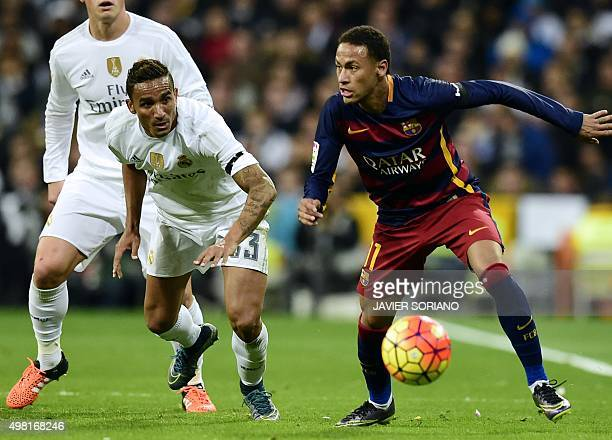 Barcelona's Brazilian forward Neymar vies with Real Madrid's Brazilian defender Danilo during the Spanish league 'Clasico' football match Real Madrid...