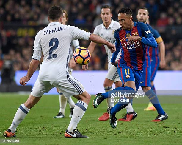 Barcelona's Brazilian forward Neymar vies with Real Madrid's defender Dani Carvajal during the Spanish league football match FC Barcelona vs Real...