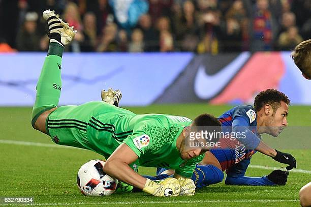 Barcelona's Brazilian forward Neymar vies with Real Sociedad's Argentinian goalkeeper Geronimo Rulli during the Spanish Copa del Rey quarter final...