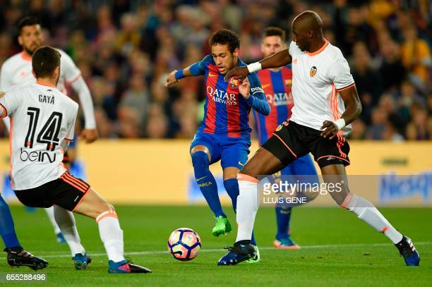 Barcelona's Brazilian forward Neymar vies with Valencia's Brazilian defender Eleaquim Mangala during the Spanish league football match FC Barcelona...