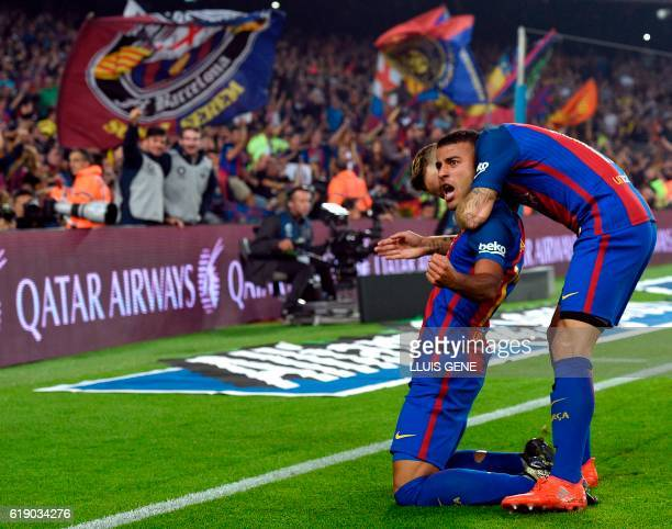 Barcelona's Brazilian midfielder Rafinha celebrates a goal during the Spanish league football match between FC Barcelona and Granada FC at the Camp...