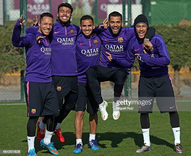 Barcelona's Brazilian players Adriano Rafael Douglas Dani Alves and Neymar pose during the FC Barcelona training session at Ciutat Esportiva on...