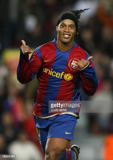 FC Barcelona's Brazilian Ronaldinho celebrates after scoring against Deportivo during their Spanish League football match at Camp Nou stadium in...