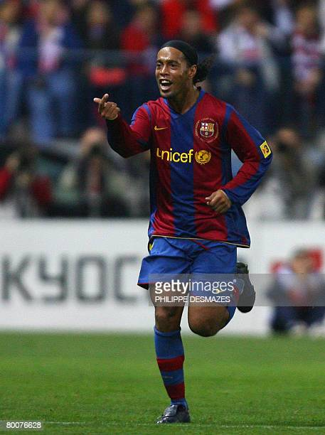 Barcelona's Brazilian Ronaldinho celebrates after scoring during a Spanish League football match Athletico Madrid v Barcelona at a Vicente Calderon...