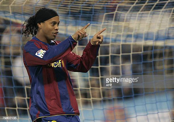 Barcelona's Brazilian Ronaldinho celebrtes his goal against Zaragoza during their Spanish league football match at Romareda Stadium in Zaragoza on...