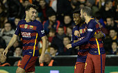 Barcelona's Cameroonian forward Wilfrid Kaptoum celebrates his goal with Barcelona's defender Vidal Aleix and Barcelona's forward Munir El Haddadi...