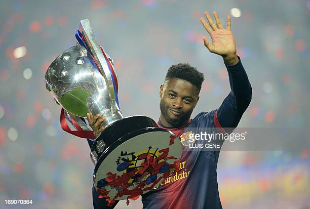 Barcelona's Cameroonian midfielder Alex Song celebrates during a ceremony at the Camp Nou stadium in Barcelona on May 19 2013 after winning the...