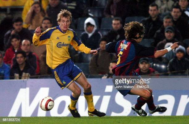 Barcelona's Carles Puyol and Brondby's Thomas Kahlenberg