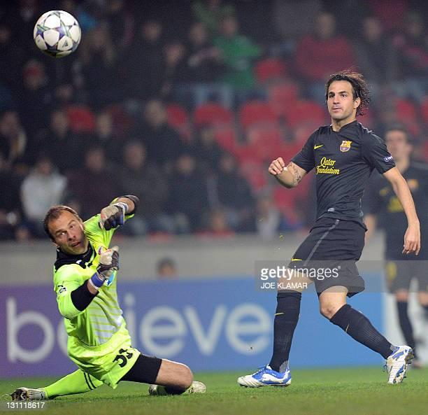 FC Barcelona's Cesc Fabregas fails to score through Roman Pavlik of Viktoria Plzen during their Championship League group H match in Prague on...