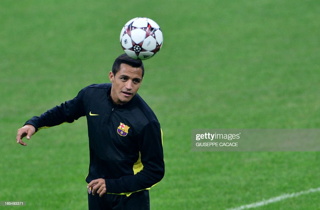 Barcelona's Chilean forward Alexis Sanchez attends a training session, on the eve of Champions League football match between AC Milan and FC Barcelona, on October 21, 2013 at the San Siro Stadium in Milan.