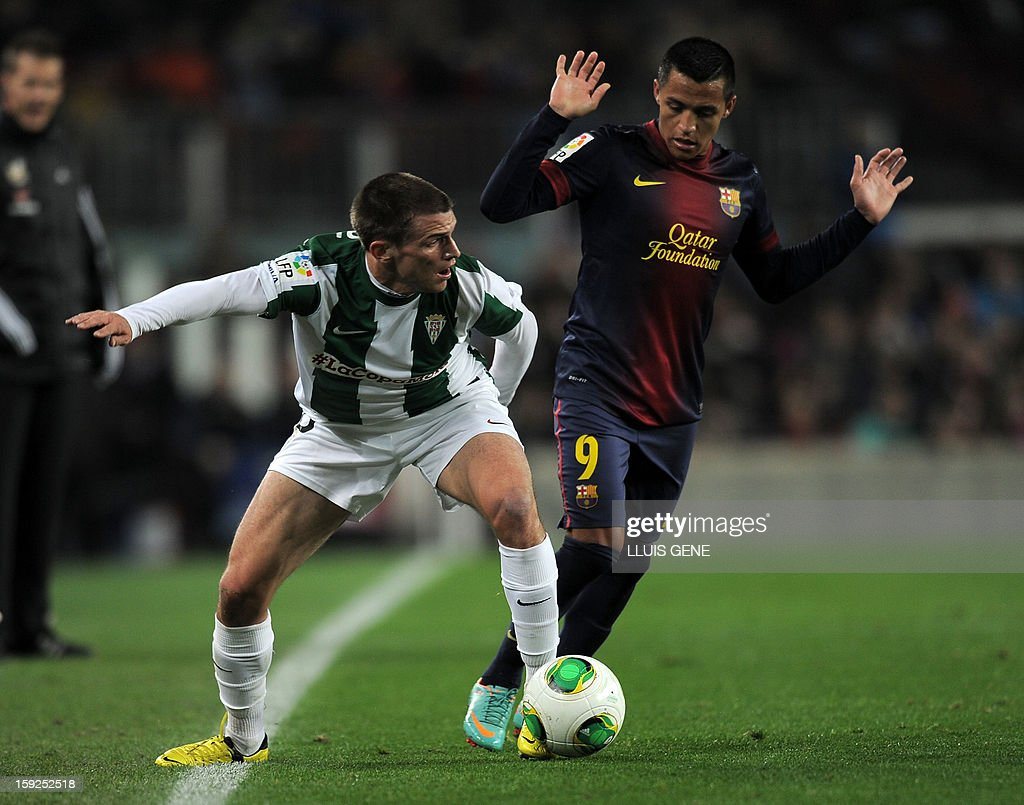 Barcelona's Chiliean forward Alexis Sanchez (R) vies with Cordoba's Argentinian forward Sebastian Dubarbier during the Spanish Copa del Rey (King's Cup) football match FC Barcelona vs Cordoba CF at the Camp Nou stadium in Barcelona on January 10, 2013. AFP PHOTO / LLUIS GENE