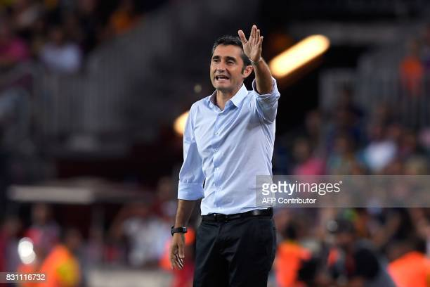 Barcelona's coach Ernesto Valverde gestures during the Spanish Supercup first leg football match FC Barcelona vs Real Madrid at the Camp Nou stadium...