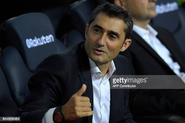 Barcelona's coach Ernesto Valverde looks on before the Spanish Liga football match Barcelona vs Espanyol at the Camp Nou stadium in Barcelona on...