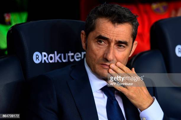 Barcelona's coach Ernesto Valverde reacts during the Spanish league football match FC Barcelona vs Malaga CF at the Camp Nou stadium in Barcelona on...