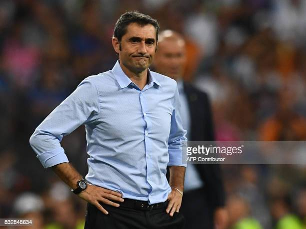 Barcelona's coach Ernesto Valverde stands on the sideline during the second leg of the Spanish Supercup football match Real Madrid vs FC Barcelona at...