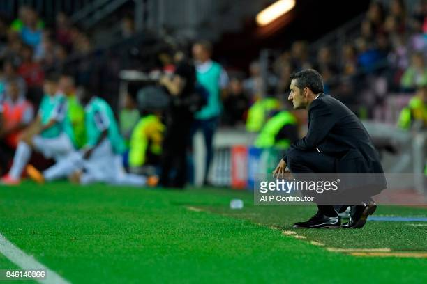 Barcelona's coach from Spain Ernesto Valverde looks on from the sideline during the UEFA Champions League Group D football match FC Barcelona vs...