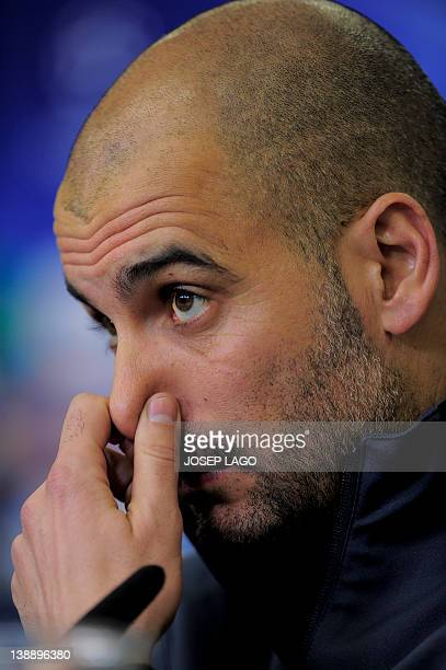 Barcelona's coach Josep Guardiola addresses a press conference on February 13 2012 prior to the UEFA Champions League round of sixteen first leg...
