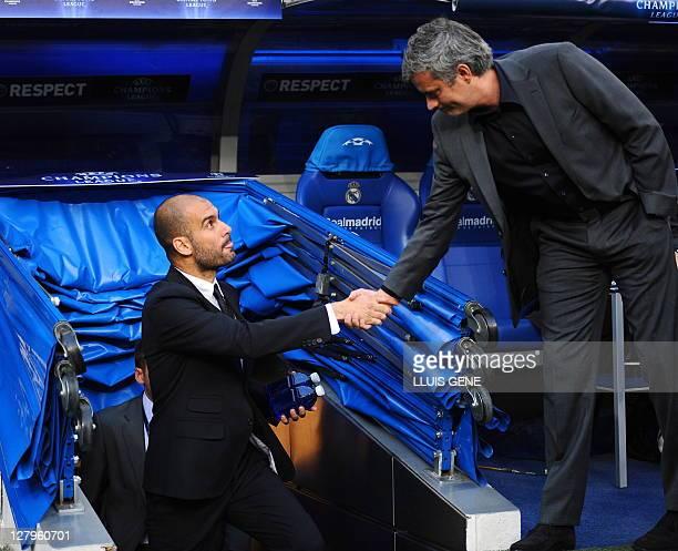 Barcelona's coach Josep Guardiola and Real Madrid's Portuguese coach Jose Mourinho shake hands before the Champions League semifinal first leg...