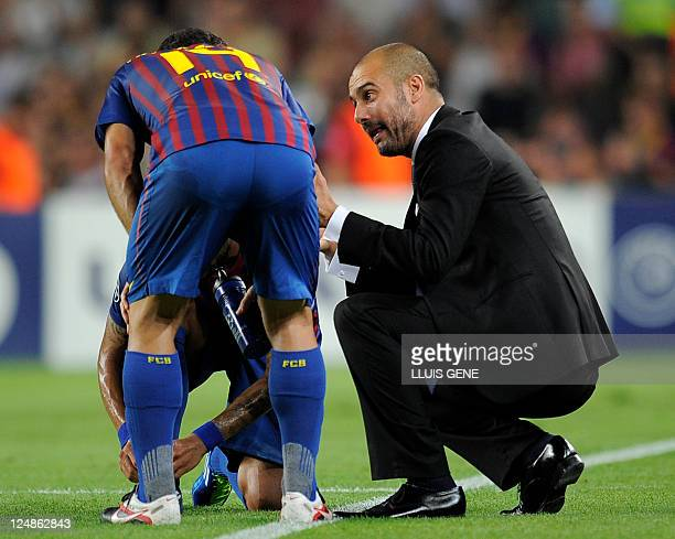 Barcelona's coach Josep Guardiola gives instructions to Barcelona's Argentinian midfielder Javier Mascherano and Barcelona's Brazilian defender...