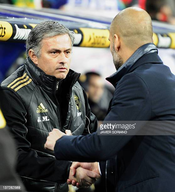 Barcelona's coach Josep Guardiola shakes hands with Real Madrid's Portuguese coach Jose Mourinho before the Spanish Cup 'El clasico' football match...