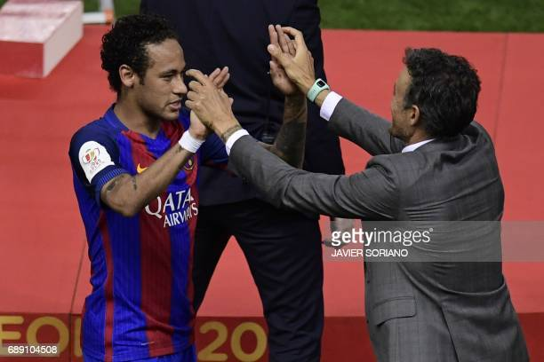 Barcelona's coach Luis Enrique and Barcelona's Brazilian forward Neymar after winning the Spanish Copa del Rey final football match FC Barcelona vs...