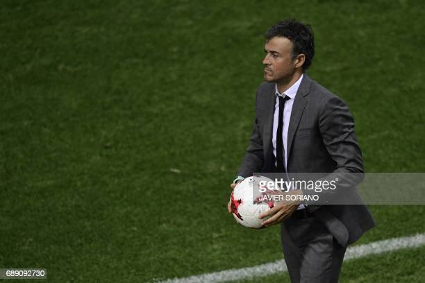 Barcelona's coach Luis Enrique catches a ball during the Spanish Copa del Rey final football match FC Barcelona vs Deportivo Alaves at the Vicente...